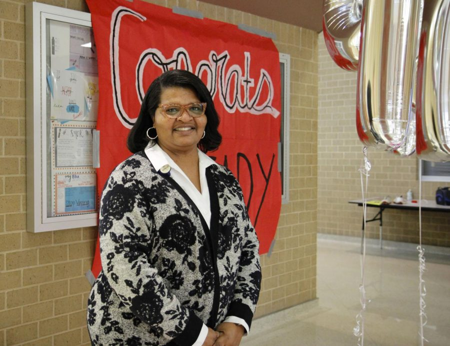 Dr. Ready poses for a picture with a sign at her congratulatory party on Oct. 29.