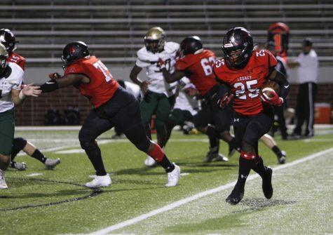 Senior John McGrady runs the ball down the field before scoring a touchdown. Broncos won 49-28. (Maija Miller Photo)