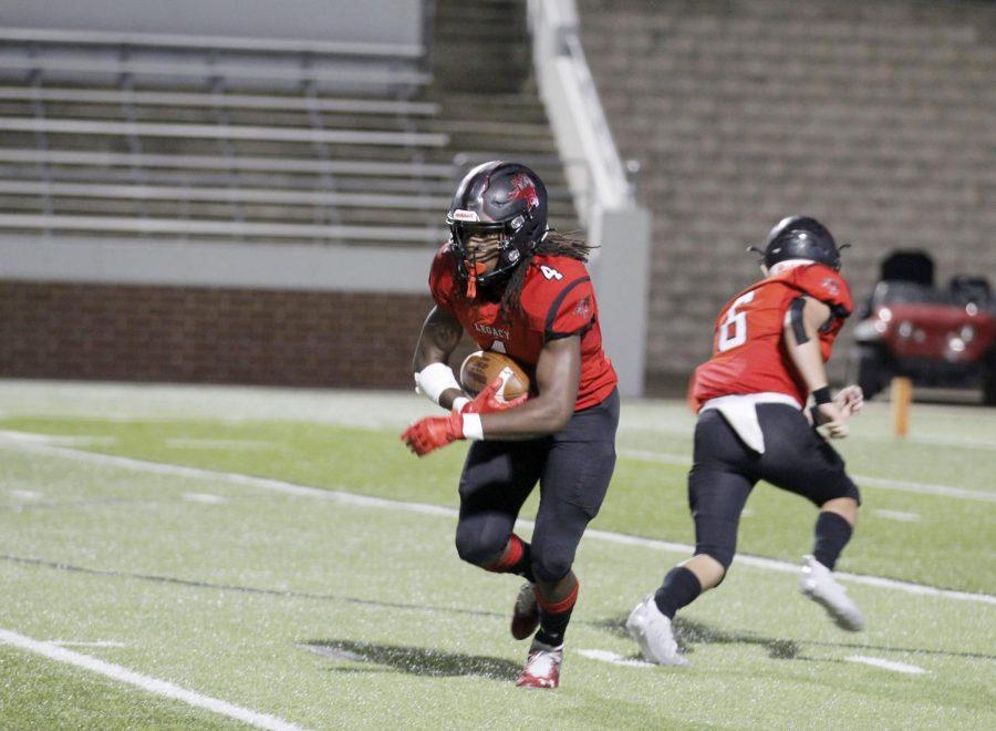 Quarterback Beau Kilgore, 11, passes the ball to running back Max Harris, 11, during the game against Birdville Nov. 5. Broncos won 49-28. (Madison Gonzales Photo)