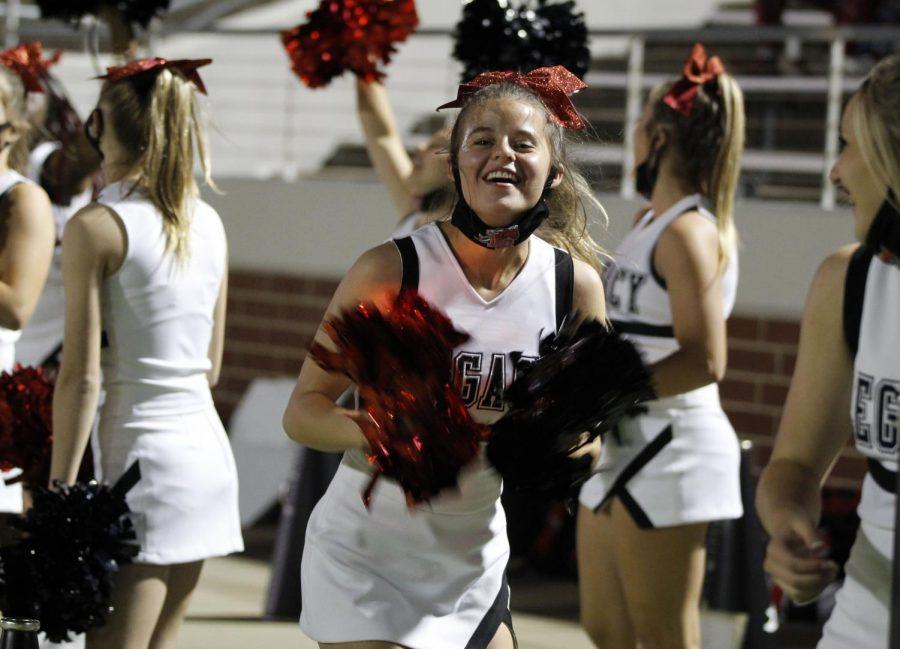 Varsity cheerleader Chloe Menefee, 10, celebrates a touchdown during third quarter. Varsity footballs next game is at 7 p.m. on Nov. 13 against Centennial. (Madison Gonzales Photo)