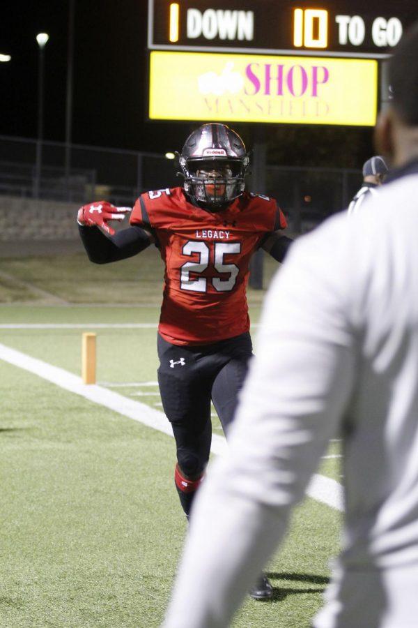 Senior John McGrady celebrates the third touchdown of the game. (Madison Gonzales Photo)