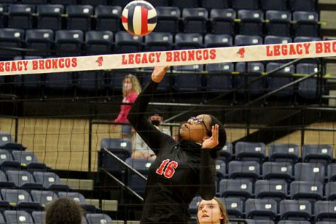 Skai Jones, 12, jumps to hit the volleyball during a game against Burleson.