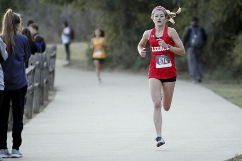 Ava Crisafulli, 10, runs at a meet at Chisenhall Fields in October.
