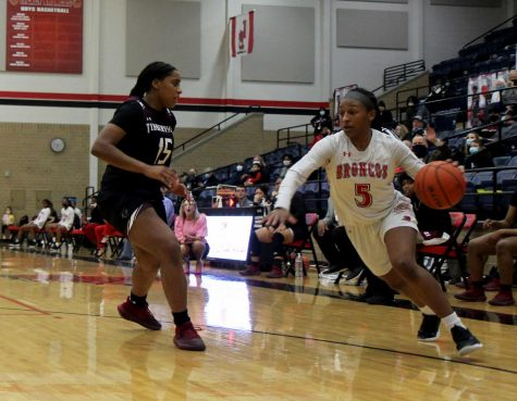 Savannah Catalon,10, drives past a defender in the game versus Timberview.