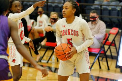Savannah Catalon, 10, looks for an open teammate at the varsity girls