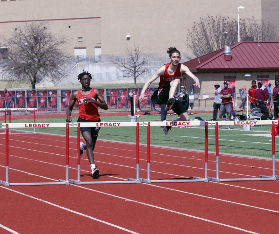 At the Bronco Relays on March 20, Nehemiah Jaime, 11, jumps over the hurdle during the 300m. (Viktoria Tapia Photo)
