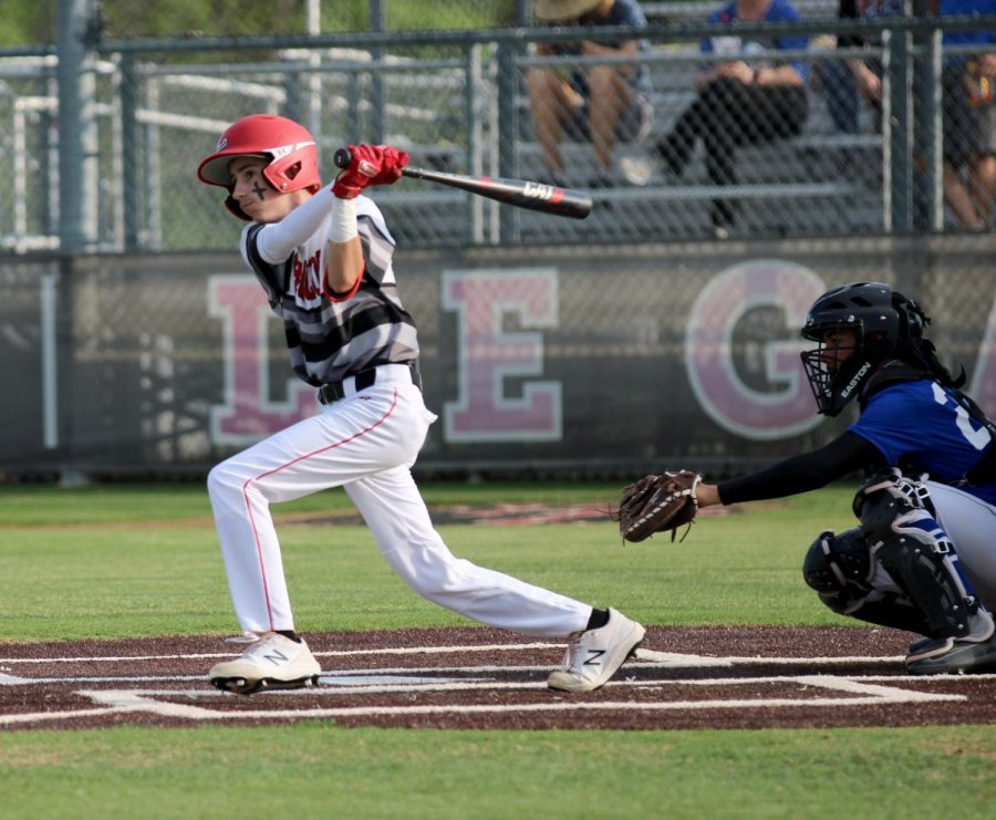 Freshman Luke Batson swings the bat on home plate at one of the games