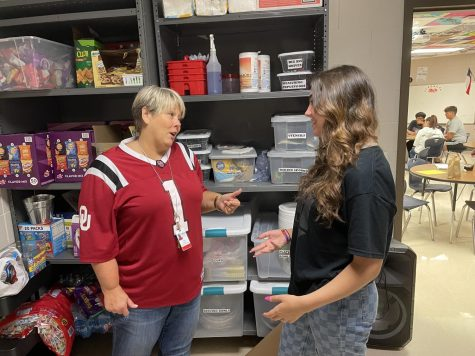 Stuco Adviser, Kenna Canvar discusses pantry items with Sudent Body President, Catherine Walworth