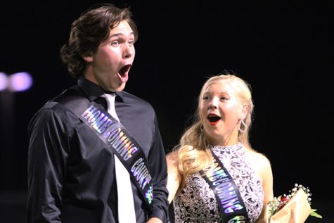 At the Homecoming game Sept. 10, Cameron Bow, 12, and Ashlyn Liukonen, 12, react to Cameron being announced as homecoming king. Students selected Melanie Ledesma, 12, as the homecoming queen.