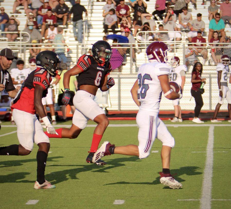 Henley-Cleveland, 6, runs towards his opponent to retrieve the football