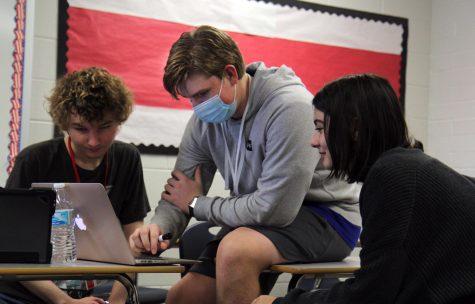 Debate President James Edwardsen, 12, works with team members to prepare for an upcoming debate.