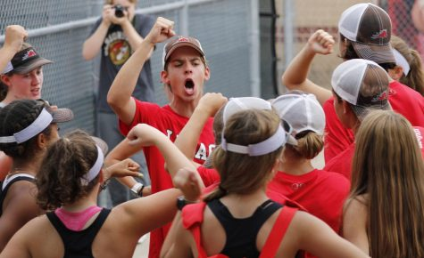 Will Mabe, 11, breaks out his team with their fight, fight, fight chant before playing Crowley. Legacy won 19-0.