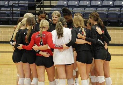 During the volleyball game against Burleson Centennial, the varsity team huddles together.