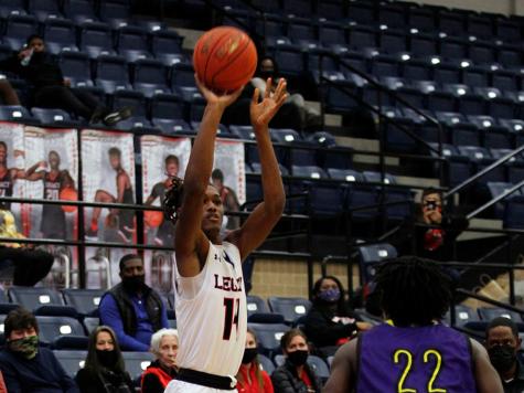 Rykeiz Smith, 12, shoots for the basket during Legacy vs Everman game last season.
