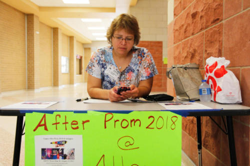 Ms. Dalia Mounce, sells after prom tickets for Alley Cats during lunch. After prom tickets will be sold by Legacy's PTSA during all lunches through May 11, for $25. (Kristen Bosecker photo)