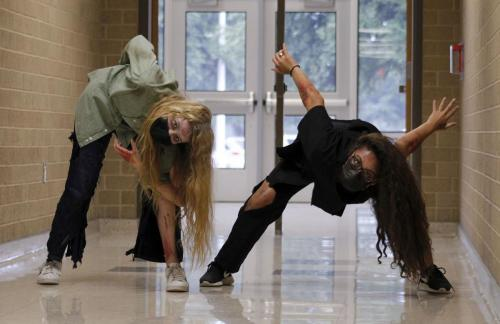 """Musical theater students, Emily Ledesma, 12, and Kailyn Rosebrook, 10, rehearse for the """"Thriller"""" dance video. In previous years, the class would perform a flash mob during lunches, but due to COVID-restrictions they are unable to do so this year. Instead they will post the video to social media on Halloween. (Avery Florence Photo)"""