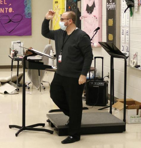 Choir Instructor, Mr. Josh Powell, demonstrates a note for his students to repeat back to him. Choir will be recording their song for a competition instead of performing live due to COVID-19. (Noah Dirnberger Photo)