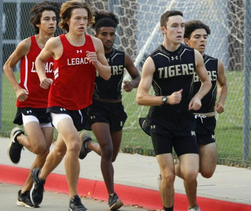 Ethan Elston, 12, builds up speed alongside Mansfield Tigers at the Cross Country meet on Sept. 19. Three MISD schools competed in the local cross country meet hosted by Legacy. The boys' cross country team placed 2nd overall in the meet. (Maija Miller Photo)