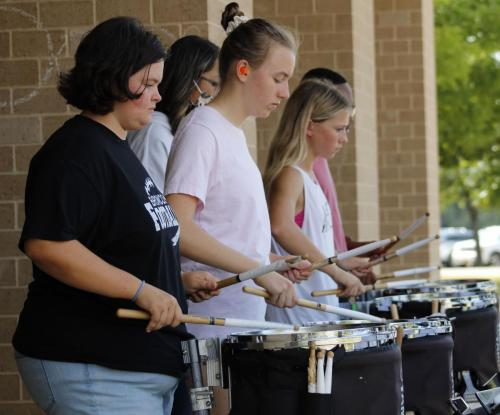 Julie Mason, 12, Caroline Norris, 11, Ashlyn Smith, 12, Sophie Stillings, 11, Christian Gardener, 11, practice with the dumline outside during 3rd period.The band will compete this weekend in Midlothian. At last week's competition, Legacy placed 4th overall. (Brennan Lotz Photo)