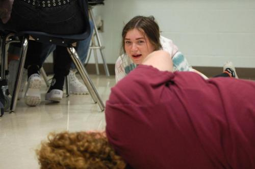 In Musical Theater class Ms. Sarah Fortune acts out being inside a whale while Cora Lewis, 12, tries to reenact and guess the place. The class played POD, a game similar to charades and telephone. (Arlo De Vera Photo)