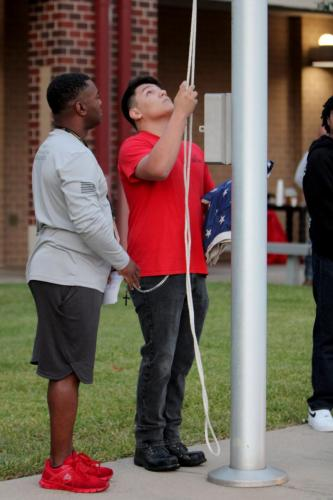 This morning at 7 in front of the school, Luis Ramirez JR., 12, and Major Sean Johnson, hang the flag up at half staff in remembrance of 9/11. Tomorrow marks the 20th anniversary since the terrorist attacks on September 11, 2021. (Catherine Walworth Photo)