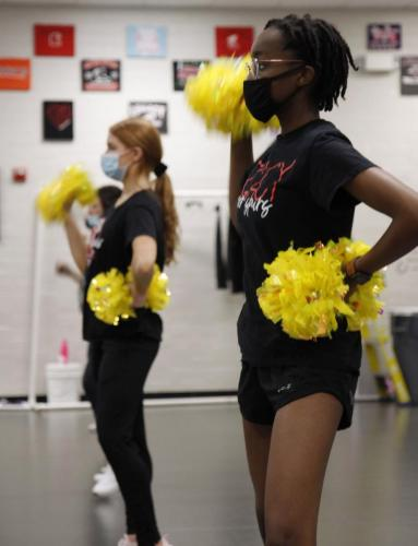 Makenzie Jackson, 11, runs through the steps of a fellow candidate's choreography. A select number of drill team members performed short choreographies in front of Coach Parlin and Coach Thomas to fill next year's officer positions for the Silver Spurs team. (Maija Miller Photo)