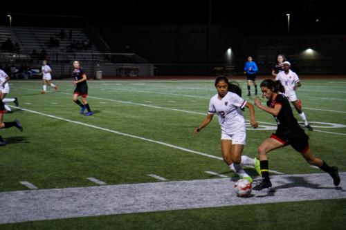 Isabelle Ryan, 12, dribbles the ball away from the Timberview defense. Varsity Girls won 7-0. (Matthew McCoy Photo)