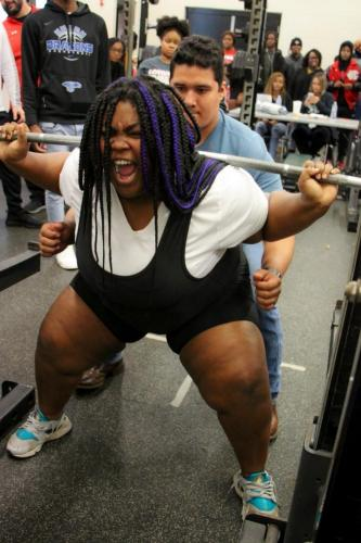 Ky'iria Beasley, 12, screams as she squats 470. Powerlifting was held at Lakeridge High school. The next powerlifting event is on Feb. 19, at Timberview High school. (Amara Shanks Photo)