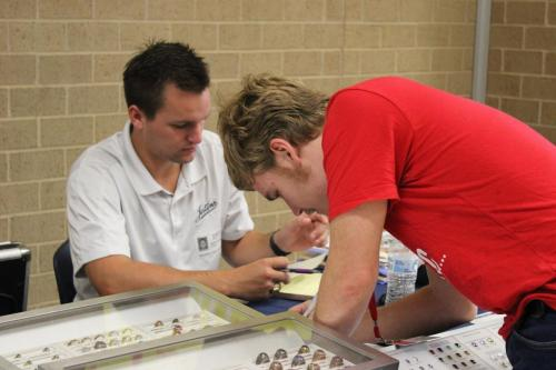 During A Lunch, David Wooddell, 12, finishes filling out forms to design his class ring. Juniors and Seniors are given the opportunity every year to customize and order commemorative class rings. (Hayley Parsons Photo)