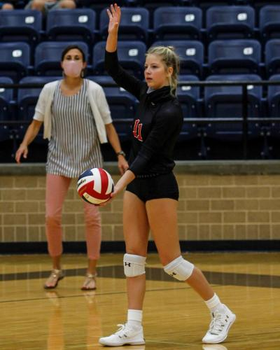 During the first volleyball game of the season, Brynn Dowd, 10, serves the ball. Legacy won 3 out of 4 sets against Lamar. Their next game is at 11 a.m. Sept. 19 against South Grand Prairie. (Madison Moyer Photo)