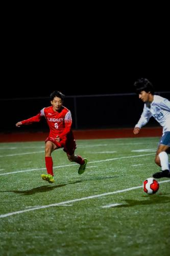 Jimmy Nguyen, 11, defends against the oncoming offender. JV A tied 0-0 against Waxahachie. (Connor Dill Photo)