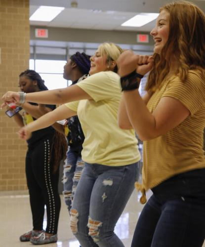Members of Student Council, Kaitly Keel, 9, and Rileigh Holloway, 11, lead Just Dance during D lunch as a part of StuCo's Hello Beautiful Week. Today's spirit day also encouraged students to wear floral print or yellow. The remainder of the days include, neon day and picking up a sticker at the StuCo store to share with a friend. (Maija Miller Photo)