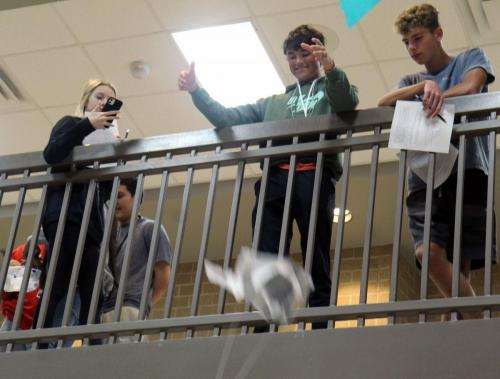 During physics class, Jarett Cook, 11, drops a dinosaur strapped to a parachute made of cut tape and limited supplies. Students competed to see who's design could fall the slowest while incorporating air resistance and terminal velocity. (Lucas Scarborough Photo)