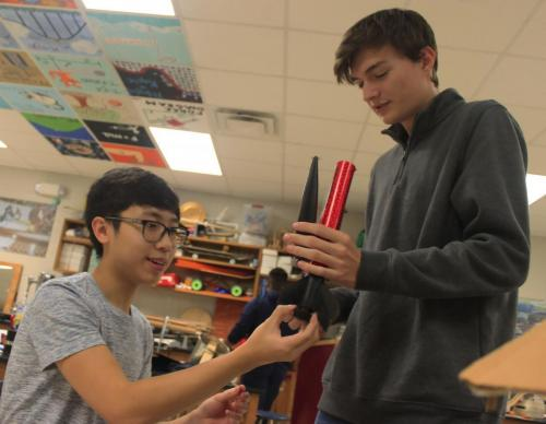 Andy Vu,12, and Matt Schnuck, 12, build rockets in AP Physics C. Students have to construct rockets that are strong enough to launch with more weight and larger engines. (Megan Novak photo)