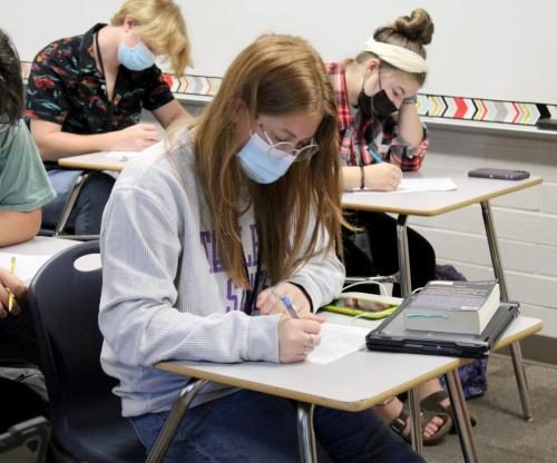IN AP English III, Brayden Bell, 11, rewrites an essay as part of her AP English Choice Board. AP English III students are currently working on an AP Choice Board to prepare for their AP Exam, 8 a.m. on May 12. (Catherine Walworth Photo)