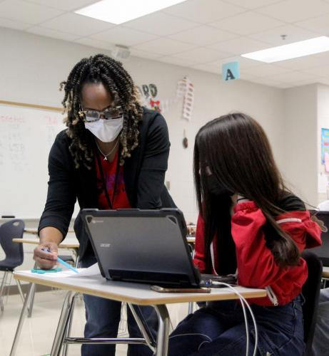 In Biology 1, Ms. Arlevia Davis helps her students with assignments. Biology 1 classes wrap up a genetics unit after taking their CBA. (Landri Hargrove Photo)