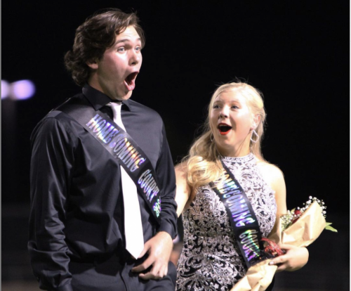 At the Homecoming game Sept. 10, Cameron Bow, 12, and Ashlyn Liukonen, 12, react to Cameron being announced as homecoming king. Students selected Melanie Ledesma, 12, as the homecoming queen. (Hayley Parsons Photo)