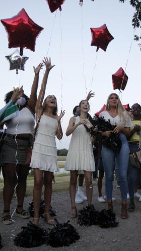 Drill team seniors Emma Moore, Emma Rae, and Kaitleigh Newman release their balloons at Senior Sunrise. Senior Sunrise was hosted at Creekwood Church by senior parents. (Madison Gonzales photo)