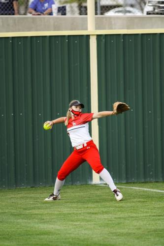 During the varsity volleyball game at Legacy on March 30, Ashlyn Rushing, 10, throws to the shortstop from the left field. Legacy won 19-2 against Seguin. (Connor Dill Photo)