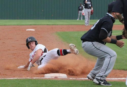 At the senior night varsity baseball game on April 27, Easton Steenbakkers, 12, steals third base. legacy defeated Everman High School, 7-1 making them district champions. The team will now advance to the playoffs. (Landri Hargrove Photo)
