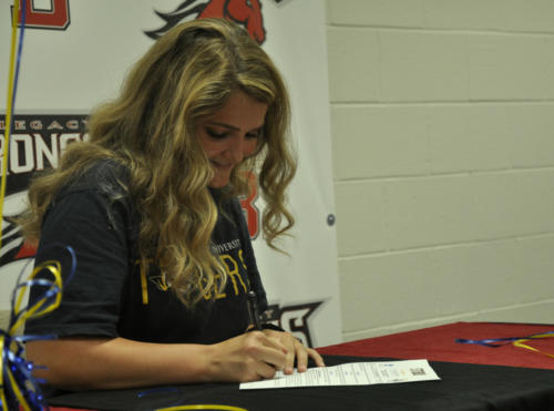 Kelsey Roberts, 12, signs her Letter of Intent to play tennis in college. Roberts plans on attending East Texas Baptist University in Marshall, Texas. (Landry Pedroza photo)
