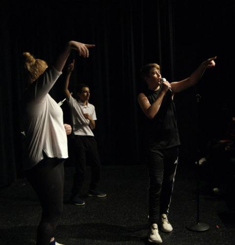 """Jackson Crutchfield, 9, performs a mock concert of Queen's """"Another One Bites the Dust"""" with his group in Theater 1. (Catherine Walworth photo)"""