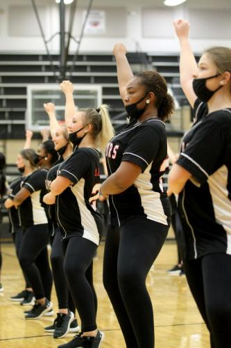 After a livestream homecoming performance, varsity drill team members Samantha Alsabrook, Aubrey Armstrong, Zaria Ayers and Abigail Beasley practice their game-day routine. Drill team will perform at halftime, against Red Oak, at Newsom Stadium. (Landri Hargrove Photo(