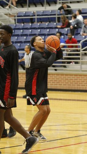 Dejuan Sims, 10, warms up before the JV boys basketball game on Dec. 3 against Mansfield High School. The JV team suffered a loss with a final score of 53-82. Varsity defeated MHS. (Amara Shanks photo)