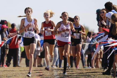 Ava Crisafulli, 9, runs at the State 5A Cross Country meet in Round Rock. Crisafulli, the only runner who qualified from Legacy, placed 84 out of 150 runners. (Delayne Fierro photo)