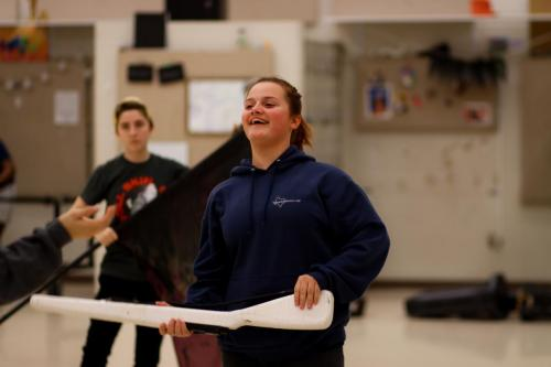 Caitlyn Kwasnick, 11, catches a rifle during winter guard rehearsal. Varsity winter guard placed 4 out of 12 on their Feb. 1 competition. (Conner Riley Photo)