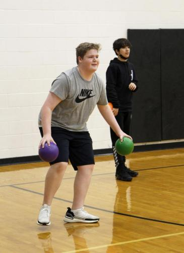 During second period, Luke Stevenson, 9, plays dodgeball. The P.E. class normally plays games outside, but the bad weather made them take their class inside. (Madison Moyer Photo)