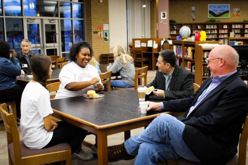 Iyanna Nunn, 12, eats breakfast with school board members. Student council members and teachers were able to sit down and converse with members over a nice breakfast. (Hayley Parsons Photo)