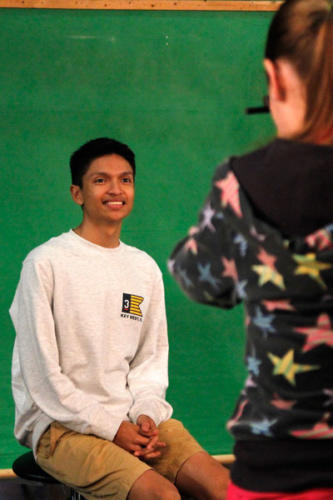 Jose Luis Nelmida Leon, 11, smiles as his yearbook picture is taken by a photographer from Impressionists School Portraits. Retakes and makeups will be taken on October 16. (Kassidy Duncan photo)