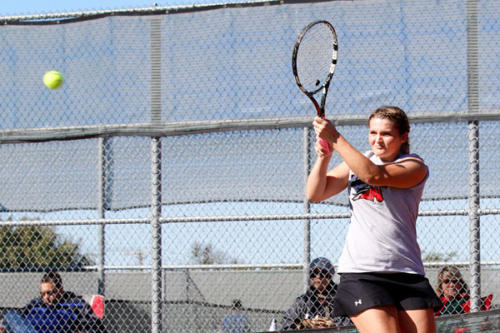 Kelsey Roberts, 12, rallies against her opponent during a doubles match at the Gobbler Tournament on Nov. 15. The boys doubles team placed third overall, and girls singles won consolation. (Delayne Fierro photo)